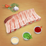 Pork ribs with tasty sauces and spices. Mustard, ketchup, garlic Stock Photography