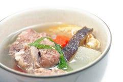 Pork ribs and vegetable soup Stock Image