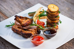 Pork ribs and vegetables Royalty Free Stock Images