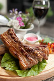 Pork ribs on wooden plate Royalty Free Stock Image