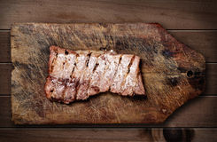Pork ribs on wooden table. Stock Images