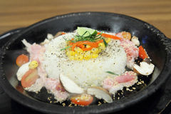 Pork rice and herb in hot pan Royalty Free Stock Photo
