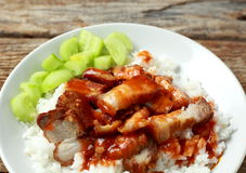 Pork on rice with red sauce Stock Photography