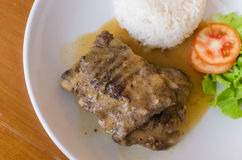 Pork with rice and salad. On plate Royalty Free Stock Photography