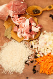 Pork, rice, spices and bay leaf for pilaf Stock Photo