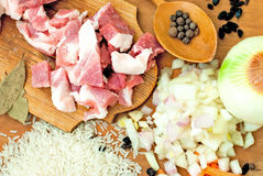 Pork, rice, spices and bay leaf for pilaf Stock Photography