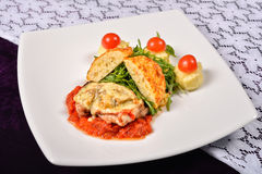Pork rind cheese with tomato and pepper sauce, mashed potatoes,. Meatballs vegetables and cherry tomatoes stock photo