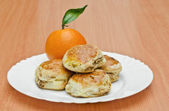 Pork rind cookies and orange. Pork Rind biscuits and orange on the plate, Shallow DOF Royalty Free Stock Photos