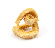 Pork rind scratchings. On white background Stock Photos