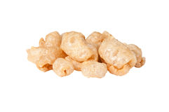 Pork rinds. Fried pork rinds over a white background Stock Photography