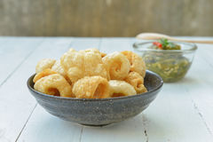 Pork rinds also known as chicharon or chicharrones, deep fried p Stock Photo