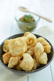 Pork rinds also known as chicharon or chicharrones, deep fried p Stock Photos
