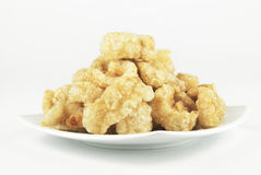 Pork rinds also known as chicharon deep fried p Royalty Free Stock Photos