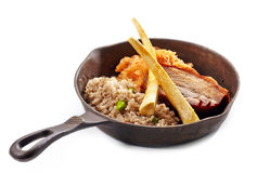Pork roast and barley porridge Royalty Free Stock Images