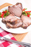 Pork roast cut in pieces with salad Royalty Free Stock Image