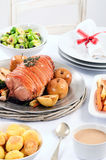 Pork roast dinner with vegetable, potato sides and wine for chri Royalty Free Stock Photo