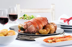 Pork roast dinner with vegetable, potato sides and wine for chri Stock Images