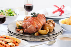 Pork roast dinner with vegetable, potato sides and wine Royalty Free Stock Photos