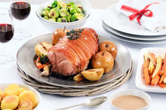 Pork roast dinner with vegetable, potato sides and wine Stock Images