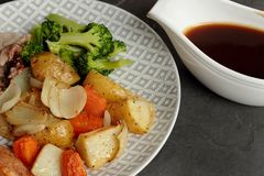 Pork roast dinner with vegetables and gravy Royalty Free Stock Image