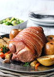 Pork roast main course with vegetables Stock Photo