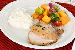 Pork Roast Meal Served with Potatoes and Vegetables royalty free stock images
