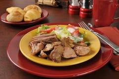 Pork roast and salad Royalty Free Stock Photo