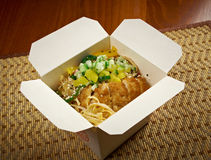 Pork roasted and udon-noodle. take-out food. Take-out food.Pork roasted and udon-noodle.chinese cuisine in take-out box Royalty Free Stock Photography