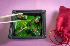 Pork rolls with chopsticks Royalty Free Stock Photo