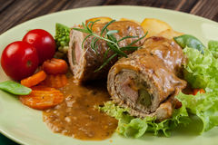 Pork rolls with prepared potatoes and vegetables Royalty Free Stock Images