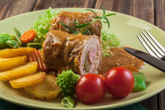 Pork rolls with prepared potatoes and vegetables Stock Image