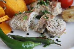 Pork rolls with pumpkin Stock Images