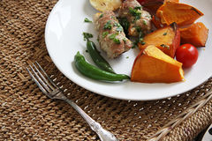 Pork rolls with vegetables Stock Photo