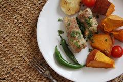 Pork rolls with vegetables Stock Images