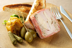 Pork Roulade dish. Dinner on plate with knife and pork Stock Photo