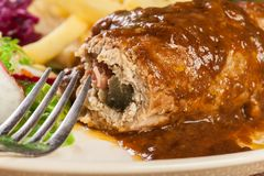 Pork roulade with french fries with salad. On a plate Royalty Free Stock Images