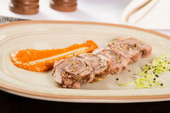 Pork roulade. With mustard seeds and carrot puree Stock Photography