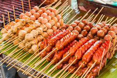 Pork's ball and sausage grilled on fried. Selling in generally street markets Stock Photography