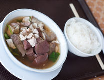 Pork's entrails and blood jelly soup with rice Stock Photos