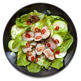 Pork Salad on Black Plate Isolated Top View Royalty Free Stock Photography