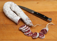 Pork Salami Sausage on Chopping Board Royalty Free Stock Images