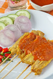 Pork Satay. National dish popular in many other Southeast Asian countries  Sa tay is Grilled pork with yellow curry powder Stock Photo