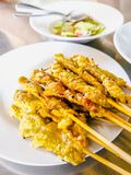 Pork satay, BBQ marinated pork served with peanut butter sauce. Appetizer dish. Pork satay, Grilled marinated pork served with peanut butter sauce and white stock images