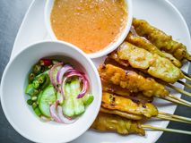 Pork satay, BBQ marinated pork served with peanut butter sauce. Appetizer dish. Pork satay, Grilled marinated pork served with peanut butter sauce and white royalty free stock photos
