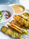 Pork satay, BBQ marinated pork served with peanut butter sauce. Appetizer dish. Pork satay, Grilled marinated pork served with peanut butter sauce and white stock image
