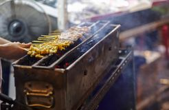 Pork satay grilling on stove or Thai style roasted pork at the market royalty free stock images