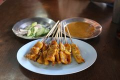 Food. Pork Satay with peanut sauce pickle with cucumber and onion slide in vinegar stock photos