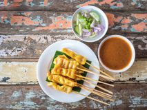 Pork satay with peanut sauce on wooden table stock images