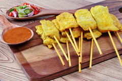 Pork satay served with Thai cucumber chili sauce and nut sauce are home made in big size Royalty Free Stock Photos