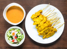Pork Satay Set. Pork Satay Set has cooked and preparing to enjoying for lunch on the wood table Stock Photo